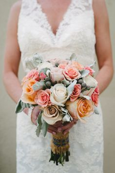 #Bouquet   Peach, coral and greay bouquet - http://www.StyleMepretty.com/illinois-weddings/chicago/2014/01/10/casual-elegance-at-peggy-notebaert-nature-museum/ T&S Hughes Photography