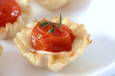Roasted Tomato Cups with Fontin and Thyme.  So adorable...can't wait to try it with fresh tomatoes from the garden!