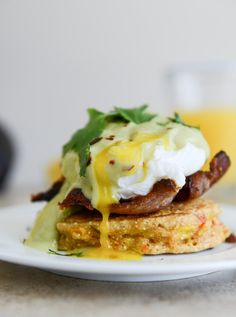sweet corn cake eggs benedict with avocado hollandaise