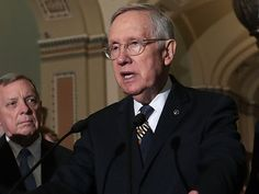 Outgoing Senate Minority Leader Harry Reid shrugged when asked on Tuesday if he supported the...