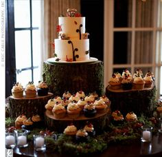 To tie in the woodland theme, the wedding cake, topped with fondant acorns and mushrooms, was displayed on a stack of moss-covered logs.