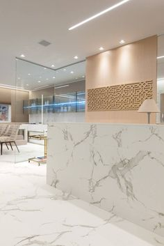 With Dekton Aura used for flooring and for the reception desk, this space by architect Cris Mioranza! This material is great for high traffic areas. #architecture #design