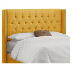 """Diamond-tufted headboard with nailhead trim and pine wood frame. Handmade in the USA.Product: HeadboardConstruction Material: Solid pine frame, metal legs, polyester and polyurethane foam padding and fabric upholsteryColor: French yellowFeatures: Handmade in the USADimensions:   Full:  56"""" H x 61.5"""" WQueen:  56"""" H x 67.5"""" W King:  56"""" H x  76"""" W California King:  56"""" H x  87"""" WNote: Easy assembly requiredCleaning and Care: Spot clean only"""