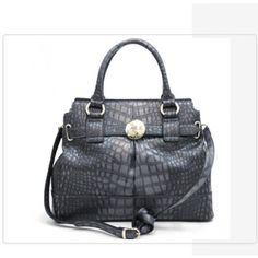 Who doesn't love an elegant Satchel Handbag that can be worn with so many different outfits & wardrobe changes?   This Satchel is perfectly made for the on-the-go Lady ...  Visit www.LenMelekard.com/outfitideas.html for purchasing info.