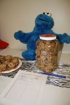 sesame street: cookie monster, guess how many cookies in the cookie jar (put child's initial on cookie, since cookie monster introduces letter of the day)