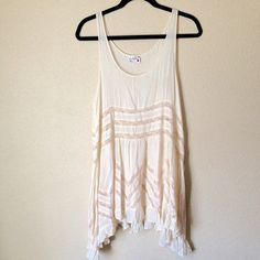 Free People Cream Trapeze Dress Beautifully made dress by free people. Tear in the lace but is not noticeable at all. I was unaware it was there till a did a close examination of the dress Free People Dresses