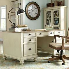 Create a comfortable work space with this executive desk. With a textured driftwood finish and bun feet, it brings beauty as well as utility to the home office. Features include a drop-front drawer with a 2-outlet powerbar, removable pencil tray, and wiring access hole.