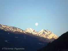 "My ever-favorite ""Sunrise Moonrise"" photo!   I took this picture one morning during early Spring! ...  a very rare sight, indeed!    Val di Sole, Trentino Alto-Adige, Italia"