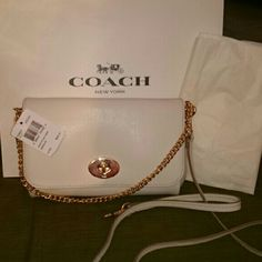 "coach mini Ruby White,NWT Gorgeous white bag. 3 in 1 bag. New to Coach for Spring /Summer Season. Gold hardware. Very Elegant! Day to night bag. Use it as a cross body or carry it on your shoulder or take strap off and carry it by the gold chain for a night on the town. 9""L x5""H. Bag depth 1.5"" strap drop is 20.5. Absolutely gorgeous!! coach Bags Crossbody Bags"