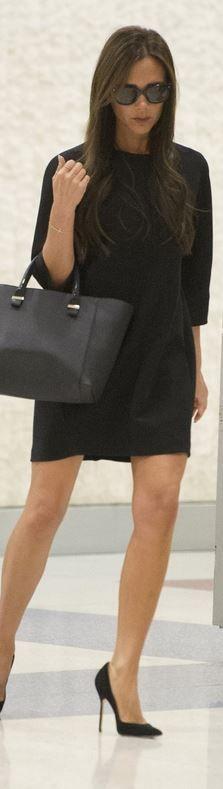 Victoria Beckham: Purse and sunglasses – Victoria Beckham  Shoes – Manolo Blahnik