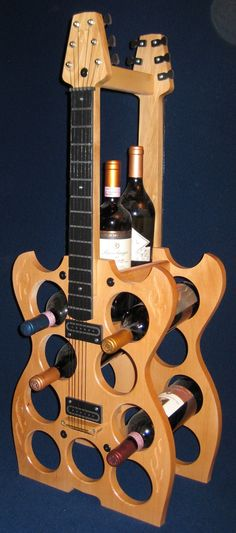 Wine, wine, wine, wine, wine, wine!  At almost three feet tall, this guitar wine rack holds six wine bottles with its sturdy, 1″ pine construction.
