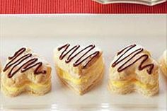 Baked puff pastry hearts are split and filled with almond-flavored pudding. For a pretty touch, the tops are glazed then decorated with chocolate.