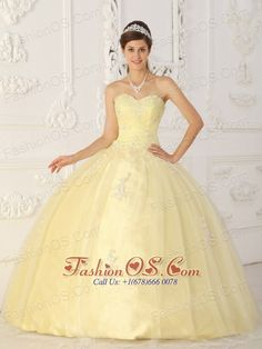 New Light Yellow Sweet 16 Dress Sweetheart Taffeta and Tulle Appliques Ball Gown  http://www.fashionos.com  Sweetheart dresses are one of the sexier styles on the market today. This one features a strapless bodice with wrapped details and a pretty jeweled brooch in the center. The amazing A-line skirt is reminiscent of the old fashioned hoop skirts and adds another dimension of beauty to an already lovely gown.