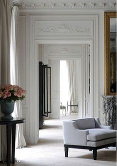 repetition of doorways creating length and allowing rooms to borrow light from other rooms. Great space making technique.