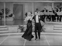 Fred & Ginger in Roberta (1935). Lovely bias cut ball gown with simple elegant lines.
