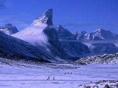 Meet Canada's Mount Thor: The World's Steepest, Tallest Cliff - Condé Nast Traveler