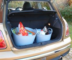 Use Rainbow Trugs in the car boot to stop the shopping rolling about