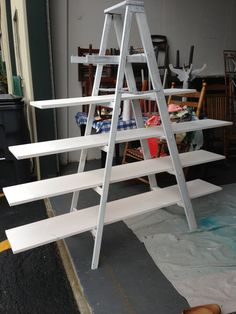 New antique booth display. Love the wood ladders!