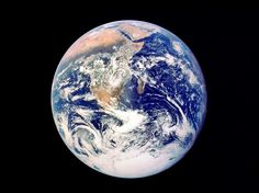 """The """"Whole Earth"""" photograph—also known as the """"Blue Marble""""—was the first to depict the entire planet. Shot in December 1972 by the crew of Apollo 17 (from a distance of 28,000 miles), the picture reveals the Arabian Peninsula, the African continent, and the Antarctic polar ice cap. Over the years, each of the three astronauts aboard the spacecraft—Eugene Cernan, Ron Evans, and Harrison H. Schmitt—claimed to have taken it. From NASA/Getty Images."""