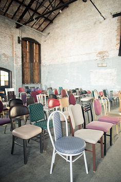 Mixing and matching ceremony chairs is an original way hone your wedding style without splurging on décor. These diverse chairs make for eccentric seating and complete this industrial 19th century factory.