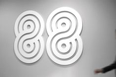An interesting design that made me think of the infinite symbol, it's supposed to be a logo for 88, that's not at all the first thing that I thought of when I saw it. It has a stencil outline that makes it look like a race track, yet it manages to look appropriate and stylistic. Designer - Eddie Opara