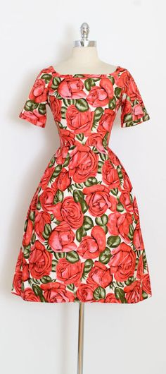 ➳ vintage 1950s dress * gorgeous bright rose floral * textured cotton * oversize rose print * gauze lined skirt * metal back zipper * by Wendy the Heart of Fashiuon condition | excellent fits like xs/s length 41.5 bodice 16.5 bust 34-36 waist 24 bodice allowance 2 hem allowance 3.5 ➳ shop http://www.etsy.com/shop/millstreetvintage?ref=si_shop ➳ shop policies http://www.etsy.com/shop/millstreetvintage/policy twitter | MillStVintage fa...