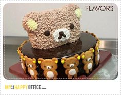 Rilakkuma cake - love the biscuits around the base, but the head on top is creepy