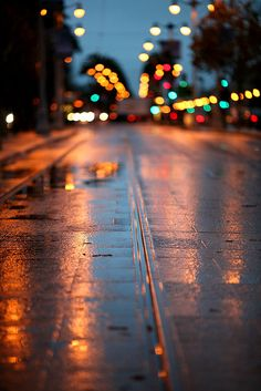 Wet tracks - By Thomas Hawk, via Flickr / / Bokeh / After the rain / Night city lights