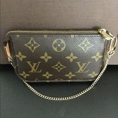 Authentic Louis Vuitton Monogram Mini Pochette Hey ladies! This is my first time selling on Posh I usually sell my 100% authentic LVs on EBay, I've heard awesome things about this app so I want to give it a try! All my items are REAL I despise fakes. This mini pochette is in EXCELLENT CONDITION. The canvas is perfect. It has a little honey patina, it is very clean inside. Only flaw I see is a tiny pen mark on the tag inside no where else besides that and a tiny dot stain on the back of the…