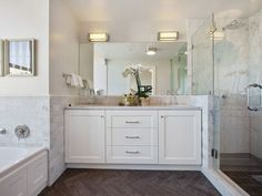 A walk-in shower, marble accents and a jetted tub complete the master bathroom. Photo: Open Homes Photography Slate Bathroom, White Marble Bathrooms, Double Sink Bathroom, Bathroom Renos, Bathroom Renovations, Master Bathroom, Double Sinks, Pacific Heights, California Homes