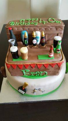 Bar pub cake, fondant pints of beer, wine bottles. 40th birthday chocolate and vanilla cake
