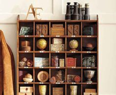 Use a mounted wall cubby to mix 'n' match smaller travel trinkets: