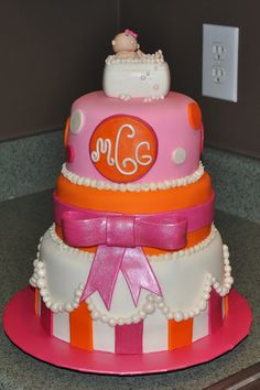 Pink and Orange Baby Shower Cake.but dr.seuss cat in that hat themed