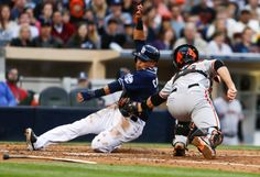 San Diego Padres' Everth Cabrera is out at home as San Francisco Giants catcher Buster Posey tags him in the fifth inning of a baseball game Saturday, April 19, 2014, in San Diego. Cabrera was trying to score from third on an infield grounder. (AP Photo/Lenny Ignelzi)