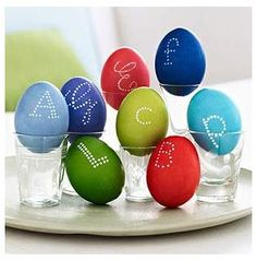 "Decorate your home with these crafty ideas for Easter eggs. Letter-Perfect-Display monogrammed eggs in shot glasses for place settings with a personal touch.  Here's how: Follow dyeing directions on ""Egg Dyeing 101,"" slide 7. Pick a favorite font from your computer for inspiration. Using a white paint pen, create letters out of a series of dots on the surface of eggs."