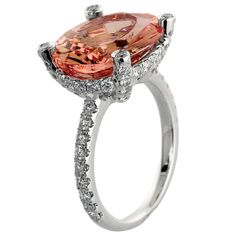 Indulge in some eye candy with this morganite ring set in a band of 18k white gold.