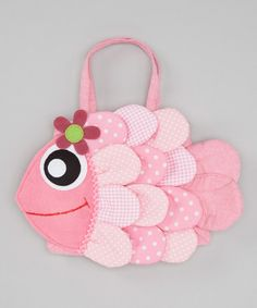 A fancy fish decorates this pretty-in-pink bag, and a roomy interior leaves plenty of space for a little darling to toss in and tote her everyday essentials. 10'' W x 7'' HShoulder drop: 4'' longPolyesterSpot cleanImported