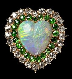 Brooch of opal, demantoid garnets, and diamonds, circa would love this with rubies in place of garnets.then it would have all of our birthstones, Cyndi's (diamond) Joey's (Opal) & mine (ruby) Opal Jewelry, Heart Jewelry, Jewelry Box, Jewelery, Fine Jewelry, Garnet Jewelry, Jewelry Making, Antique Jewelry, Vintage Jewelry