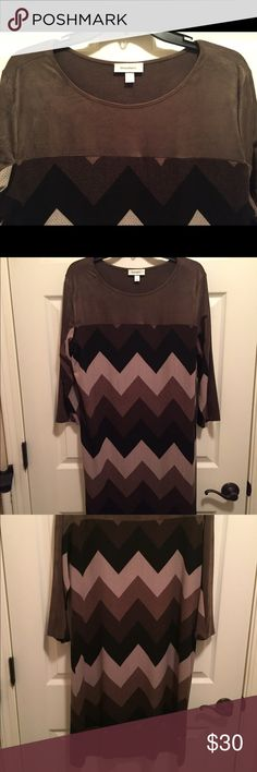 Long Sleeve Print Dress in brown Great dress for any occasion. Can dress it up with boots or wear heels. 95% Polyester 5% Spandex. Brown, black & cream in color. Dress Barn Dresses Long Sleeve
