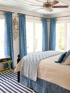 The Classic ~ Blue and white is a classic color combination that brings a warm comfort to any bedroom. The blue paisley curtains and bed skirt contrast nicely with the creamy white comforter. The striped cotton rugs add a casual cottage feel to the room. Another color option plays out overhead: The planked ceiling is painted a soft sky blue