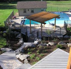 Springfield landscape job by The Site Group including overlook deck and pergola by the pool.