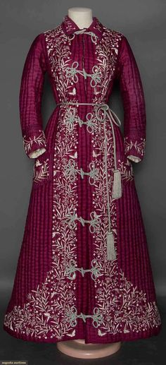 EMBROIDERED EXPORT ROBE, 1870-1880 Magenta China silk, ivory silk lining hand quilted w/ thick batting, ivory surface embroidery of vines, flowers, & butterflies, silk tassel cord tie, 2 patch pockets, 7 pale blue frogs. auctioned from Strong Museum, Rochester, N.Y.