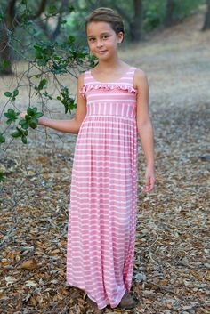 Lovely tulip pink and playful white stripes give this sweet maxi dress an innocent charm, while the comfortable knit fabric and flowing silhouette make this girls' spring dress a versatile choice for play or special occasions. Stretchy elastic waistband Ruffle embellishment on bodice Soft jersey knit washes and wears well Designed by Five Loaves Two Fish