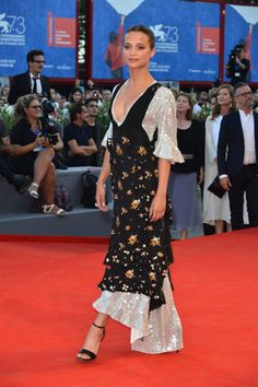 Alicia Vikander in a Louis Vuitton dress on the red carpet in Venice