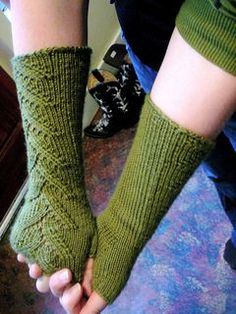 foilage lace knit wrist cuffs. My go-to wrist cuff pattern. I only make them to the wrist and that way they only take one skein.