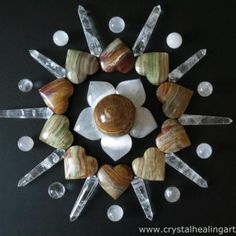 I love how the heart-shaped stones of this crystal grid make it look like a blooming flower. So gorgeous. Love these crystals!