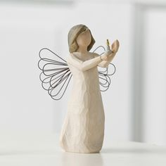 The Angel of Hope figurine depicts an angel with wire wrapped wings holding a lit candle up in her hands as if to light the way. It's a lovely piece with multiple meanings. It can stand for a symbol o
