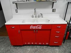 unique coca cola sink. great in a retro kitchen...would be awesome in my house with all my coke stuff!