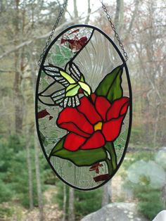 Hummingbird and red rose stained glass panel.