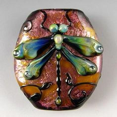 dragonfly bead-you could also probably use this technique on a larger base such as a flat rock to make a paper weight